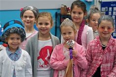 Wonder what our Lower School students will look like at 100 years old? See our 100 day photos, where they all dressed up as if they were 100.