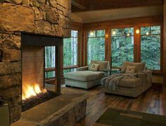 Cozy living room and fire place with a view! Want!