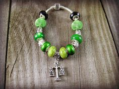 Scales of Justice Charm Bracelet Silver Scales Libra Charm Euro Charm Bracelet Euro Beads Bracelet Snake Chain Mixed Green Beaded #jewelryonetsy #etsyfashion