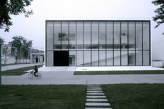 Glass facade of the Lushi Hill Club in Beijing by Atelier Fronti.