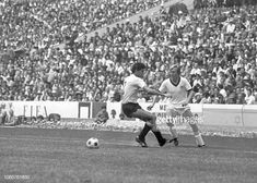 2d385e66e German national team player Sigi Held in a duel with a player from Uruguay  in the game for third place at the 1970 Football World Cup at Aztec.