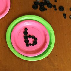 Quiet bins ideas for the year! Love this watermelon one that has preschoolers forming letters out of buttons!