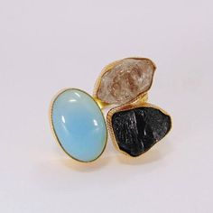 Aqua Chalcedony Ring - Gold Plated Ring - Herkimer Diamond Ring - Bezel Set Ring - Three Stone Ring - Tourmaline Ring - Adjustable Ring Product Details Item Code: BR-0436 Gross Wt. 10.00 Gms Stone Name: Aqua Chalcedony, Herkimer Diamond, Apatite Metal: Yellow Gold Plated Over Brass