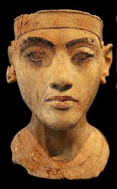 King Tutankhamun limestone portrait bust, New Kingdom, 18th Dynasty of around 1335 BC, in Amarna, Egypt. As a unifying principle, Tutankhaten converted to Amunism and changed his name to Tutankhamun.