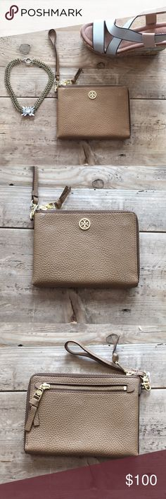Wristlet | Tory Burch Brown Tory Burch wristlet. Never been used. Was Christmas gift so tags are off Tory Burch Bags