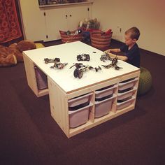 DIY lego table made with 2 IKEA Trofast storage units and a custom cut MDF board. Total cost = $200 #AnnaVersaciDesign