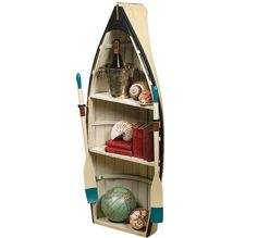 boat bookshelf and boat table. Have this exact one. Love it!!