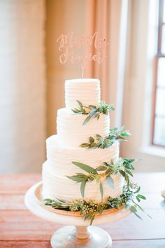 A dreamy and elegant cake with greenery. Early Mountain Vineyard Wedding