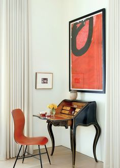 contemporary art and chair with antique desk