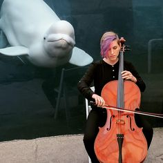PsBattle: women playing the cello for a beluga