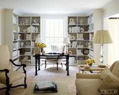 The living room, which also serves as Lee's office, includes desk lamps from John Rosselli Antiques & Decoration and an antique armchair.    - ELLEDecor.com
