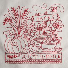 The best traits of each season are stitched in RedWork quilt blocks.