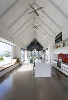 Love the length, the ceilings, the floors, the long bench seating window. Farmhouse / RTA Studio + Interior Shop + Loft