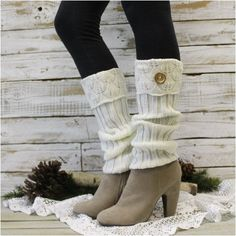"""A charming and cozy cream button cuff leg warmer. The charm of this cozy knit leg warmer is wonderful. The 3"""" cuff is a delicate leaf patterned knit design complimented with a real wood button. A grea"""