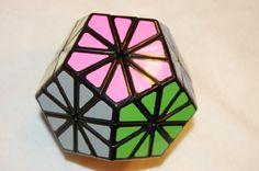 Amazon.com: QJ 12-color Chrysanthemum Dodecahedron Puzzle Cube Black: Toys & Games