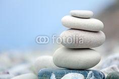 Fototapete Bachlandschaft - Pyramid of stones on Cyprus beach
