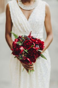 A Wedding Planner's Glamorous Cocktail-Style Brooklyn Wedding, Vibrant Red Bouquet of Peonies | Brides.com