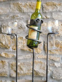 Outdoor Wine Bottle and Glass Set, hand forged iron rods you push into the ground that hold your glass and bottle. Great for Barbeque, Blacksmith is HammerOnSteel, available on Etsy.  Very cute idea, and so useful