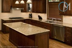 Another example of why an excellent contrast between the granite and cabinetry is never a mistake. The granite featured is Santa Cecilia and it offsets the dark brown wood nicely.