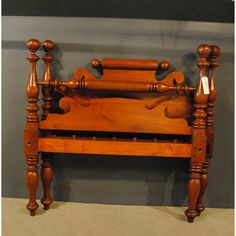 pBalltop lowpost bed in Maple, circa 1840 is original size. This bed can accommodate double size bedding on a plywood foundation. Features rolltop repeat end rams ear headboard, turned blanket rail, footboard and heavy rails with rope knobs./p