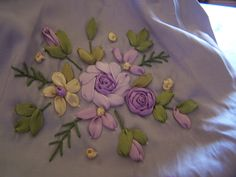 Closer view of all that hand work of ribbon embroidery ...