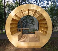 This outdoor bench-bibliotheque brings new meaning to the phrase 'surrounded by books.' Promising to bring intellectuals outdoors, this gazebo features a small table for lunch or tea, and easy-to-clean slatted wooden floors. Photo courtesy of Ruetemple Architectural Studio.