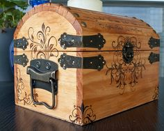 A pirate styled chest with Victorian styled flourishes and vines, Latin text written upon the lid, oh, and a cute little bat on the back. The front corners have a wrap around design that can be fully seen at an angle.    This chest measures about 7.75 (front) x 6 x 6 inches, with 3.25 inches of depth on the inside not including the top.    All designs and writing are drawn with a wood burning tool that takes hours to complete by hand. Afterward the chest has been sealed with polyurethane to…