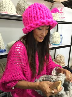 Waejong Kim - cofounder of Loopy Mango wearing Loopy Mango Helsinki Hat and Ryan Roche sweater and knitting with Big Loop Yarn