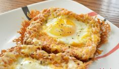 """Combining her love for cheesy eggs with eggs """"over easy,"""" try this delicious Cheesy Baked Egg Toast for breakfast. Breakfast Dishes, Breakfast Time, Breakfast Recipes, Breakfast Ideas, Egg Recipes, Cooking Recipes, High Protein Breakfast, Egg Toast, Baked Eggs"""