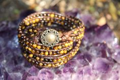 This Tiger Eye Triple-Wrap Bracelet brings twice the power of the crystal properties it features.