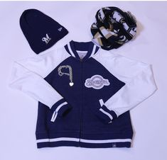 Get this look at the #Brewers Team Store:  Women Women's Vest- $79.00 Knit Hat- $35.00 Heart Charm Necklace- $40.00 Brewers Scarf- $30.00