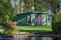 A green painted x Expression garden room. Used as an office in the middle of a beautiful large garden with a pond. Green Painted Rooms, Garden Office, Pond, New Homes, Outdoor Structures, House Styles, Gallery, Building, Plants