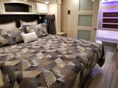Beachfront decor in bedroom of this Luxe 39FB Elite. Luxury Fifth Wheel, 5th Wheels, Build Your Own, Comforters, Floor Plans, Flooring, Blanket, Bedroom, Building