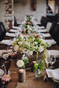 Rustic woodland wedding reception with white and green boxed floral centerpieces | Long Way Home Photography | See more: http://theweddingplaybook.com/a-romantic-woodland-wedding/
