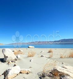 Zen Rocks White Sand Blue Lake - Stock Footage | by Iam2012escapee