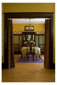 An Edwardian Gilt Framed Portrait Overlooks This Wood Panelled