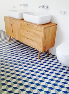 Jule uses the Jenson Sideboard in Solid Oak as a sink, dreamy with graphic geometric white and blue flooring. White Bathroom, Bathroom Interior, Modern Vintage Bathroom, Brick In The Wall, Dark Stains, Wet Rooms, Corner Sofa, White Decor, Bathroom Renovations