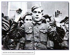 A Hitler Youth man surrenders. The defiance and urge to fight still shows on his face. Such was the fanaticism of the Hitler Youth
