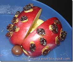 Apple Ladybugs with red apple body, peanut butter for frosting, raisens for dots for and a grape for the head.