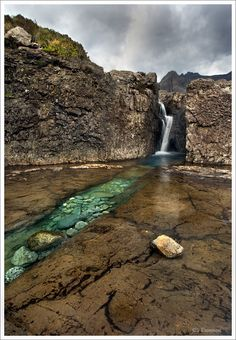 The Fairy Pools on the Isle of Syke, Scotland are a series of clear, cold pools and waterfalls. #BucketList