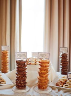STACKS of Doughnuts! How wonderful!! See the rest of the wedding on SMP --  http://www.StyleMePretty.com/2014/01/13/los-angeles-wedding-at-the-park-plaza/ Esther Sun Photography