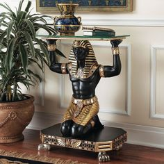 Add Egyptian majesty to your entryway or hall with the Design Toscano Servant to the Pharaoh Glass-Topped Console Table . The base of this console table. Egyptian Furniture, Egyptian Home Decor, Egyptian Decorations, Egyptian Kings, Egyptian Art, Egyptian Goddess, Egyptian Crafts, Console Table, Sofa Tables
