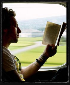 looks almost like he's reading w/ his eyes closed - I knew he was talented!  hee hee ;)