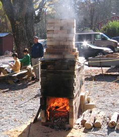 Demonstration wood-firing kiln at Hand in Hand Gallery, NC  Firing underway with the added soft brick chimney.