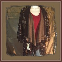 Poncho Style sweater Vest This Poncho Style sweater vest features a two-tone brown Southwestern Print. Perfect for brisk nights!! Super soft&comfy, like being wrapped in a blanket Size: Fits True to Large!!                                                                 Suggested User Top Rated Seller  Fast Shipper Bundle Feature  Pet/Smoke Free Home PayPal/Trades Sweaters Shrugs & Ponchos