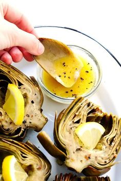 Seriously the most amazing roasted artichokes recipe! They're stuffed with lots of garlic and herbs, seasoned with lots of lemon and black pepper, and roasted to crispy, tender perfection. The perfect vegetable side dish! | Gimme Some Oven #artichokes #roasted #sidedish #vegetable #glutenfree #vegan