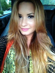 Demi. Love the hair and makeup!