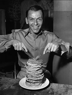 Frank Sinatra & a giant stack of pancakes. two of the most wonderful things captured into one photograph.