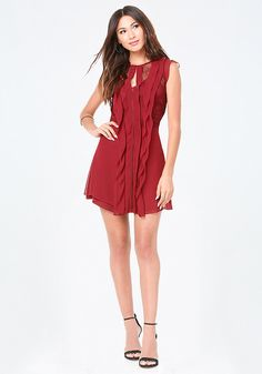 Romantic dress featuring lace insets and shoulder-to-hem ruffles. Sweet ruffle cap sleeves. Attached underslip with adjustable straps. Hidden front neck hook-and-eye closure. Hidden side hook-and-eye and zip closure.