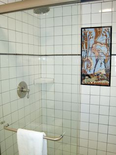 Custom Mermaid tile in The Edgewater ( Fountain View Queen Room #7).